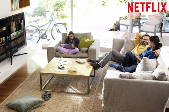 Netflix living room promo shot of parents and child